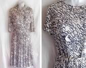 Vintage dress | 1960s Patty Petite Mad Men midcentury op art geometric print dress suit with matching jacket and belt