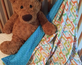 Multi colored giraffe print minky blanket