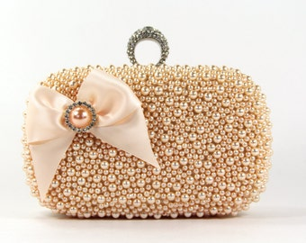 Bridal Clutch - Exquisite Peach Pearl Bridal Clutch adorned with a Lovely Satin Bow & Matching Pearl surrounded by Rhinestones - Pearl Purse