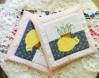 Vintage pair of hot pads pot holders quilted applique white lace yellow cat flower pot cottage chic