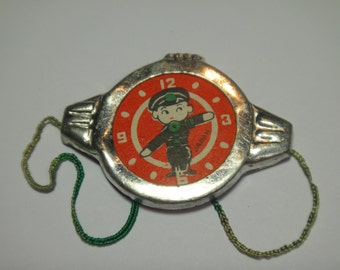 Police Vintage Tin Toy child's penny 1930's watch Japan paper and metal celebrity antique