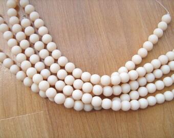 Sea glass beads opaque peach 8mm round 8 inch strand