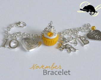 Your NOVEMBER Birthday Bracelet - Cupcake with candle, birthstone,letter,locket, and zodiac charm - Personalised (In Stock)