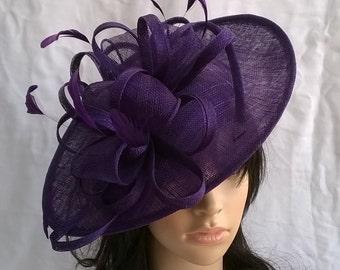 Purple Fascinator.Stunning  Purple Sinamay Shaped disc Fascinator with double swirls , loops..wedding,races