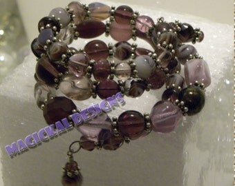 Heliotrope Bracelet - Triple spiral bracelet of purple beads