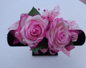 Corsage designed in real touch roses in cream-fuchsia