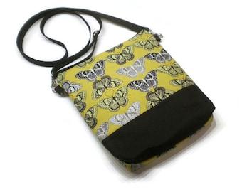 Mustard butterflies handbag, crossbody bag, shoulder purse. Two zippered pockets, 8 x 9.5 inches, adjustable strap.