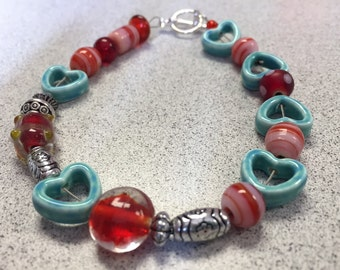 Heart turquoise and red bracelet.