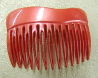 Vintage red side hair comb made in France