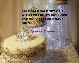 Wedding Cake Stand Cascade waterfall crystal set of 3 AsianWedding Crystal cake Stand wedding with a battery operated LED light.
