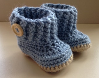 Crochet baby booties. For babies age 0-3 months. Blue with beige sole & wooden effect button detail