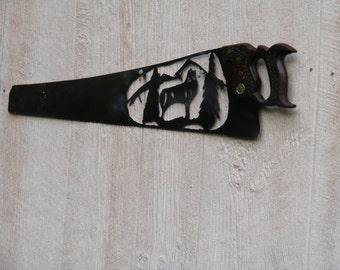 Plasma Cut Wolf on a vintage hand saw.