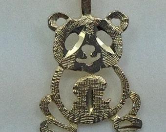 14kt gold Teddy bear charm.