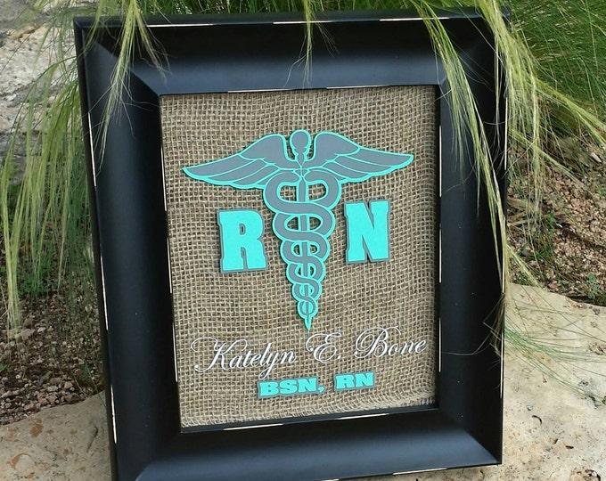 Framed RN graduation plaque.