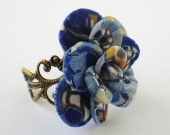 Abstract blue rose ring on adjustable band