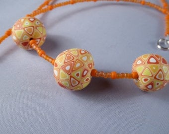 Hand made polymer clay and Japanese seed beads