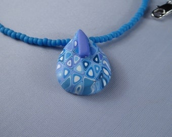Polymer clay and  the finest Japanese seed beads.