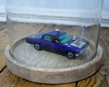 Vintage Corgi Oldsmobile (man from U.N.C.L.E) displayed under stunning glass dome