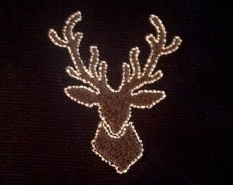 Deer head machine applique and filled embroidery design in several sizes.