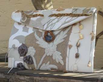 Clutch purse , Envelope clutch bag , Hand bag , Embellished clutch , Textured clutch , Designer clutch .