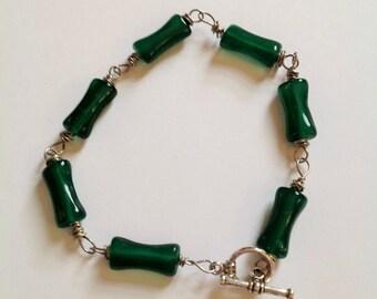Jade green dog bone shaped beaded bracelet