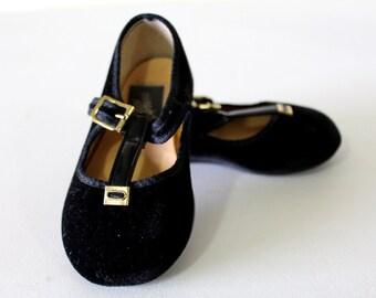 Black velvet T-strap shoes