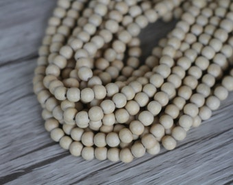 8mm Natural Whitewood - Round Wood Beads - Waxed - 15 inch strand