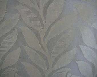 Ivory and beige poly lace in leaf pattern