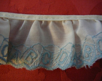 """Embroidered """"ABCs"""" ruffled cotton with scalloped edge"""