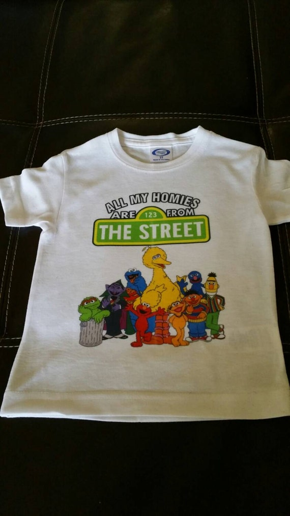 Sesame Street Clothing. Showing 48 of results that match your query. Search Product Result. Product - Sesame Street Oscar The Grouch Face Adult T-Shirt. Product - Toddler: Sesame Street- Elmo Rules Apparel Baby T-Shirt - Blue. Product Image. Price $ Product Title. Toddler: Sesame Street-Elmo Rules Apparel Baby T-Shirt - Blue.