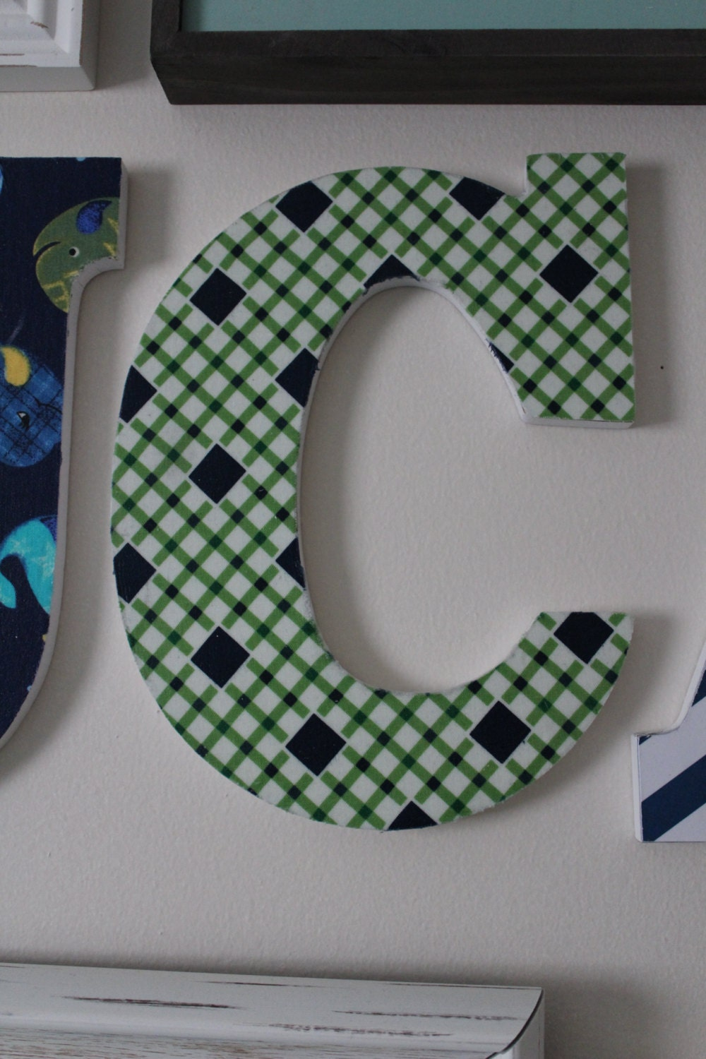 letters covered in fabric Decorete a room with your initial, as easy as 1,2, & 3 free tutorial with pictures on how to make a letter in under 60 minutes by decorating with fabric, buttons, and glue.