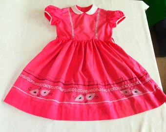 Adorable vintage summer dress for a little girl. Handmade, raspberry pink with hand embroidered designs. 1950's/1960's. For parties, picnics