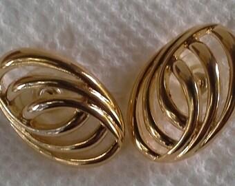 Vintage Trifari open work gold tone oval pierced earrings
