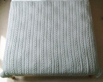 Hand knit chunky cable throw in light grey