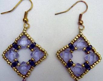 Dangling beaded earrings in triangle shape