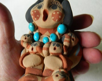 Jamez pueblo- Signed-Caroline Sando-Storyteller pottery