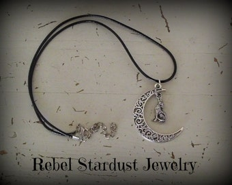 Crescent moon and howling wolf black necklace