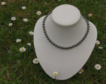 Necklace hematite beads, spacers and yellow gold clasp