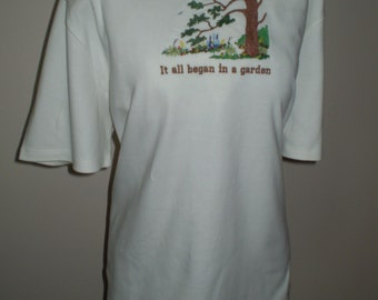 "T-shirt with logo ""It all began in a garden""."