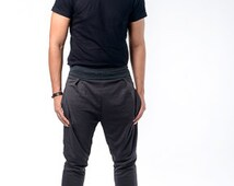 Dark gray soft joggers with side pockets and contrast green line on side
