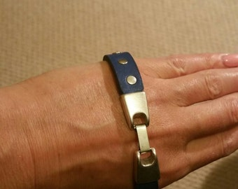 Blue leather rivet cuff with metal hardware clasp. Thick vegtan leather cut to length required for wrist size.