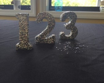 Glitter stand alone table numbers