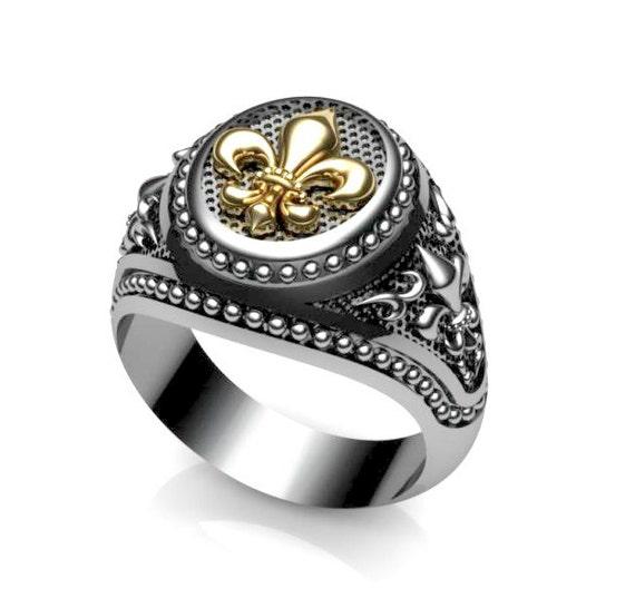 Fleur de lis ring white gold