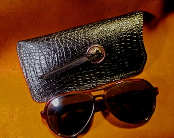 Custom eyeglass case made from a embossed gator pattern on cowhide.