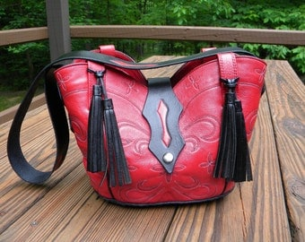 Red, Dlb. Cowboy Boot Purse, Hand Carved and Tooled front enclosure and strap.