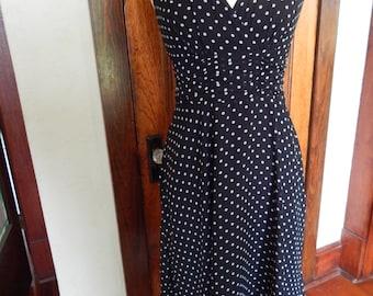 Black A-line dress with white polka dots