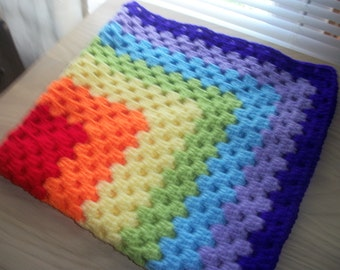 Hand crocheted baby blanket. Rainbow colours. Suitable for car seat, crib, pram or moses basket. Ideal just to wrap baby in.