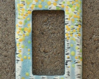 gfi/decora rocker switchplate with enameled birch trees
