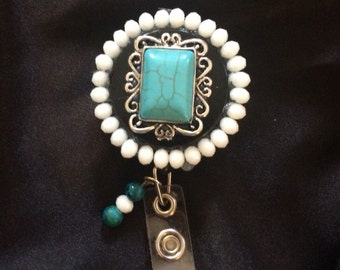 Turquoise ID badge with unique charms