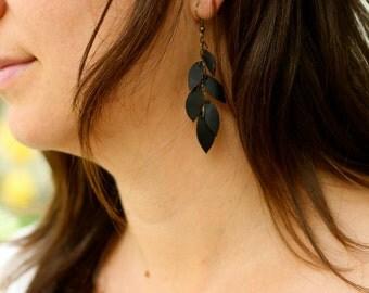 Black feather earrings - handmade from upcycled bike inner tubes.